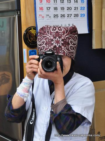 もちやさんカメラを構える